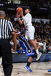 Devin Thomas (2) of the Wake Forest Demon Deacons makes contact with a Duke Blue Devils defender during first half action against at the LJVM Coliseum on January 7, 2015 in Winston-Salem, North Carolina.  The Blue Devils defeated the Demon Deacons 73-65.  (Brian Westerholt/Sports On Film)