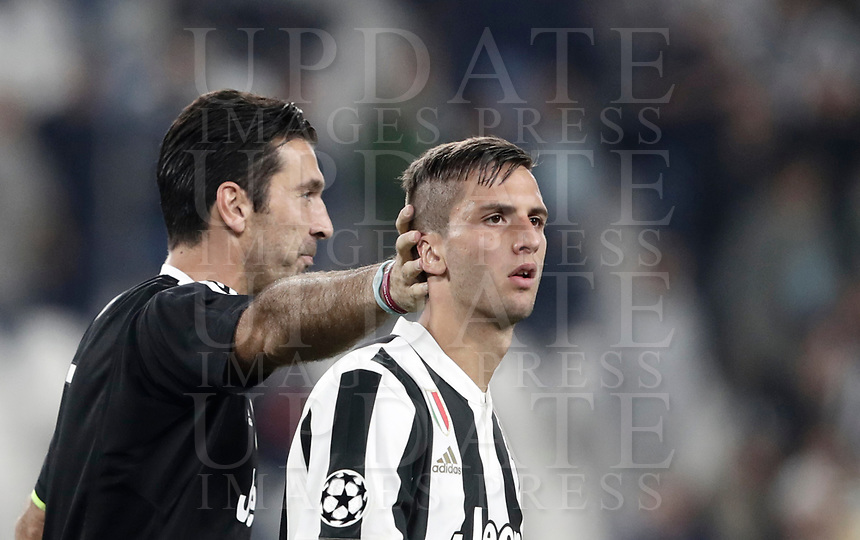 Football Soccer: UEFA Champions League Juventus vs Olympiacos Allianz Stadium. Turin, Italy, September 27, 2017. <br /> Juventus' captain Gianluigi Buffon (l) and Rodrigo Bentancur (r) celebrate after winning 2-0 the Uefa Champions League football soccer match between Juventus and Olympiacos at Allianz Stadium in Turin, September 27, 2017.<br /> UPDATE IMAGES PRESS/Isabella Bonotto