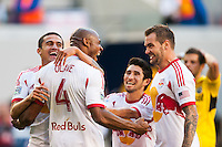 Jamison Olave (4) of the New York Red Bulls celebrates scoring with teammates. The New York Red Bulls and the Columbus Crew played to a 2-2 tie during a Major League Soccer (MLS) match at Red Bull Arena in Harrison, NJ, on May 26, 2013.