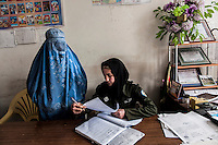 An Afghan police woman at her office at Kabul /Felix Features