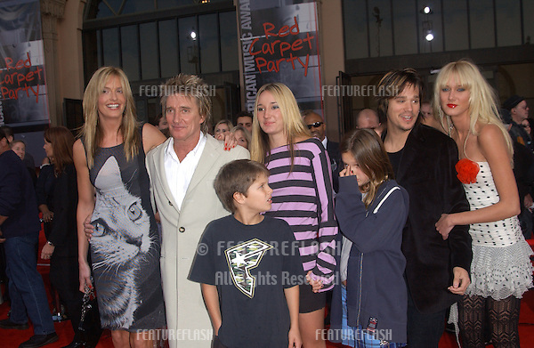 ROD STEWART & girlfriend PENNY LANCASTER & family at the 31st Annual American Music Awards in Los Angeles..November 16, 2003