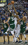 Nevada's Jordan Caroline (24) tips the ball over Colorado State's Nico Carvacho (32) in the second half of an NCAA college basketball game in Reno, Nev., Sunday, Feb. 25, 2018. (AP Photo/Tom R. Smedes)