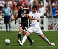 Real Madrid forward (20) Gonzalo Higuain collides with DC United midfielder (14) Ben Olsen during their friendly at FedEx Field in Landover, Maryland.  Real Madrid defeated DC United, 3-0.