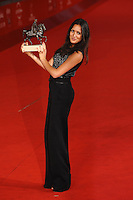 Actress Sarah Kazemy, who accepted on behalf of director Maryam Keshavarz, poses with the Marc' Aurelio Best Newcomer award for 'Circumstance'.Roma 4/11/2011 Auditorium.Festival Internazionale del Film di Roma.Award ceremony Red Carpet.Foto Andrea Staccioli Insidefoto