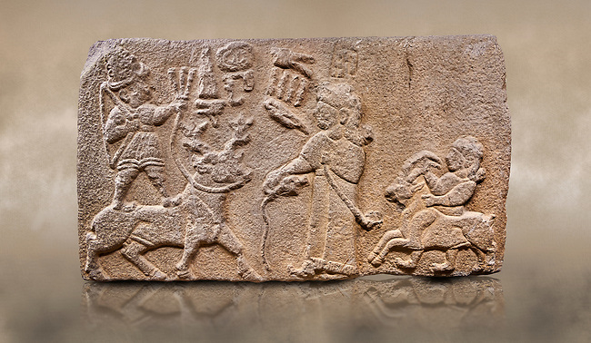 """Aslantepe Hittite relief sculpted orthostat stone panel. Limestone, Aslantepe, Malatya, 1200-700 B.C. Anatolian Civilisations Museum, Ankara, Turkey.<br /> <br /> Scene of king's offering drink and sacrifice to the god. The god is on the deer, with the bow attached to his shoulder and with a triple bundle of lightning in his hand. The king looks at the god, and makes the libation to the god while carrying a scepter with a curled end - lituus. Behind the king is a servant holding a goat for sacrifice to the god. Hieroglyphs read; """"God Parata, Strong King... """". <br /> <br /> Against a brown art background."""