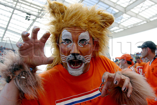 15 June 2004: A DUTCH supporter goes to the game dressed up as a lion. Euro 2004 Group D game. Germany 1 Holland 1. Estadio do Dragao, Porto, Portugal. Photo: Glyn Kirk/Action Plus. ...040615 footballer support fan fans crowd facepaint paint paints faces costume costumes