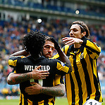 Nederland, Arnhem, 28 april 2013.Eredivisie.Seizoen 2012-2013.Vitesse-Willem ll .Theo Janssen en Mike Havenaar feliciteren Wilfried Bony van Vitesse met zijn doelpunt, de 2-0.