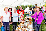 Ester O'Shea sampling the temptations in the tea party marquee at the Beaufort Treshing on Sunday with the help of Mary mcLoiughlin, Kathleen Moloney, Niamh Costello and Mary O'Carroll