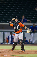 AZL Giants catcher Jeffry Parra (5) prepares to throw a ball to first base against the AZL Cubs on September 6, 2017 at Sloan Park in Mesa, Arizona. AZL Giants defeated the AZL Cubs 6-5 to even up the Arizona League Championship Series at one game a piece. (Zachary Lucy/Four Seam Images)