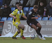 John McGinn tackles Martin Woods in the Ross County v St Mirren Scottish Professional Football League match played at the Global Energy Stadium, Dingwall on 17.1.15.
