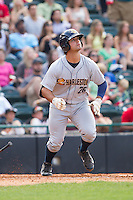 Mike Ford (26) of the Charleston RiverDogs starts down the first base line during the game against the Hickory Crawdads at L.P. Frans Stadium on May 25, 2014 in Hickory, North Carolina.  The RiverDogs defeated the Crawdads 17-10.  (Brian Westerholt/Four Seam Images)