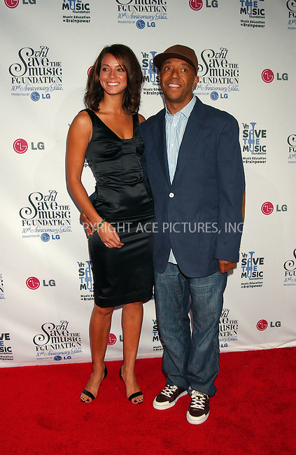 WWW.ACEPIXS.COM . . . . . ....September 20 2007, New York City....Russell Simmons and guest arriving at the VH1 Save The Music Foundation's 10th Anniversary Gala at Lincoln Center in midtown Manhattan....Please byline: KRISTIN CALLAHAN - ACEPIXS.COM.. . . . . . ..Ace Pictures, Inc:  ..(646) 769 0430..e-mail: info@acepixs.com..web: http://www.acepixs.com