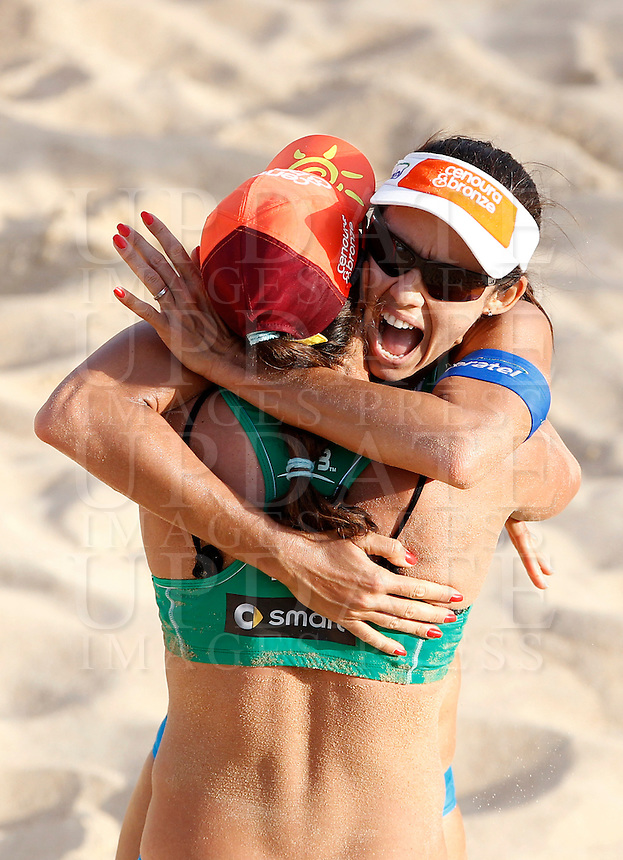 Brazil's Talita Antunes and Taiana Lima, back to camera, celebrate at the Beach Volleyball World Tour Grand Slam, Foro Italico, Rome, 21 June 2013.<br /> UPDATE IMAGES PRESS/Isabella Bonotto
