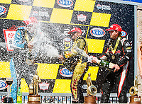 Jul 30, 2017; Sonoma, CA, USA; NHRA pro stock driver Tanner Gray (left), funny car driver J.R. Todd (center) and top fuel driver Steve Torrence celebrate after winning the Sonoma Nationals at Sonoma Raceway. Mandatory Credit: Mark J. Rebilas-USA TODAY Sports