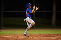 AZL Rangers Cody Freeman (33) celebrates after scoring a run during an Arizona League game against the AZL Dodgers Mota at Camelback Ranch on June 18, 2019 in Glendale, Arizona. AZL Dodgers Mota defeated AZL Rangers 13-4. (Zachary Lucy/Four Seam Images)