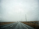 Driving car on highway in rainy weather.