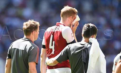 August 6th 2017, Wembley Stadium, London, England; FA Community Shield Final; Arsenal versus Chelsea; Per Mertesacker of Arsenal leaves the field injured