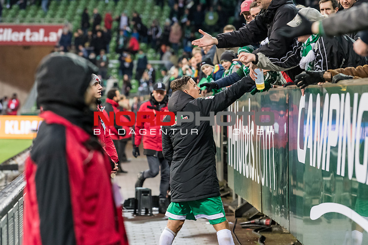 10.02.2019, Weserstadion, Bremen, GER, 1.FBL, Werder Bremen vs FC Augsburg<br /> <br /> DFL REGULATIONS PROHIBIT ANY USE OF PHOTOGRAPHS AS IMAGE SEQUENCES AND/OR QUASI-VIDEO.<br /> <br /> im Bild / picture shows<br /> Max Kruse (Werder Bremen #10) verschenkt Jubil&auml;um-Schaals an Fans nach Spielende, <br /> <br /> Foto &copy; nordphoto / Ewert