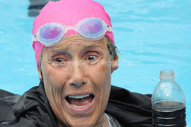 WWW.ACEPIXS.COM<br /> October 9, 2013...New York City<br /> <br /> Diana Nyad swims for 48 hours straight to raise funds for Hurricane Sandy victims in Midtown Manhattan in New York City on October 9, 2013. <br /> <br /> Byline: Kristin Callahan/Ace Pictures<br /> <br /> ACE Pictures, Inc.<br /> tel: 646 769 0430<br />       212 243 8787<br /> e-mail: info@acepixs.com<br /> web: http://www.acepixs.com