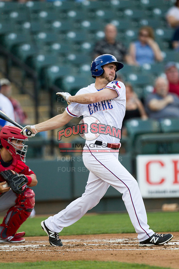 Round Rock Express outfielder Jared Hoying #30 follows through on his swing during the Pacific Coast League baseball game against the Memphis Redbirds on April 24, 2014 at the Dell Diamond in Round Rock, Texas. The Express defeated the Redbirds 6-2. (Andrew Woolley/Four Seam Images)