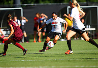 WINSTON-SALEM, NORTH CAROLINA - August 30, 2013:<br />  Charlyn Corral (9) of Louisville University cuts past Danielle King (8) of Virginia Tech during a match at the Wake Forest Invitational tournament at Wake Forest University on August 30. The game ended in a 1-1 tie.