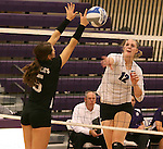 SIOUX FALLS, SD - SEPTEMBER 23: Michelle Ritland #12 from University of Sioux Falls looks to get a kill past Michaela Mestl #5 from Wayne State Tuesday night at the Stewart Center.  (Photo by Dave Eggen/Inertia)
