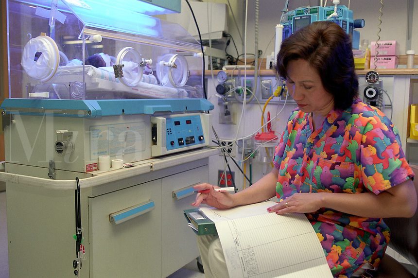A nurse at work in the neonatal intensive care unit.