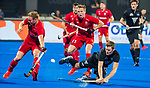 BHUBANESWAR - Stephen Jenness (NZL) with Ian Sloan (Eng)  and David Ames (Eng) .England-New Zealand (2-0)   during Wold Cup Hockey men. COPYRIGHT KOEN SUYK