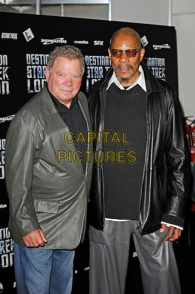 William Shatner and Avery Brooks .attending 'Destination Star Trek' London, Excel, London, England, UK, .19th October 2012..half length black leather jacket jumper grey gray black shirt glasses .CAP/MAR.© Martin Harris/Capital Pictures.