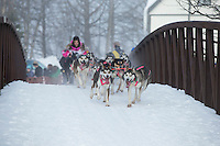 DeeDee Jonrowe runs over a bridge during the ceremonial start of the Iditarod sled dog race Anchorage Saturday, March 2, 2013. ..Photo (C) Jeff Schultz/IditarodPhotos.com  Do not reproduce without permission