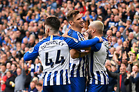 Neal Maupay of Brighton and Hove Albion right celebrates scoring the first goal with Aaron Connolly and Adam Webster of Brighton and Hove Albion during Brighton & Hove Albion vs Tottenham Hotspur, Premier League Football at the American Express Community Stadium on 5th October 2019
