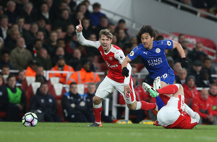Leicester City's Shinji Okazaki and Arsenal's Nacho Monreal<br /> <br /> Photographer Stephen White/CameraSport<br /> <br /> The Premier League - Arsenal v Leicester City - Wednesday 26th April 2017 - Emirates Stadium - London<br /> <br /> World Copyright &copy; 2017 CameraSport. All rights reserved. 43 Linden Ave. Countesthorpe. Leicester. England. LE8 5PG - Tel: +44 (0) 116 277 4147 - admin@camerasport.com - www.camerasport.com