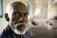 Somaliland. Waqohi Galbed province. Hargeisa. Tubeculosis (TB) hospital. Male ward. Yusuf Qawdhan Qalib is a black muslim man and a TB patient. He rests in his bed while he is taking the two months drugs as a TB treatment. The Global Fund through the ngo ( Non-governmental organization ) World Vision supports the programm with a Tuberculosis grant (financial aid). Somaliland is an unrecognized de facto sovereign state located in the Horn of Africa. Hargeisa is the capital of Somaliland. © 2006 Didier Ruef ..