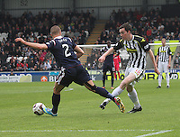 Sean Kelly plays the ball past Erik Cikos in the St Mirren v Ross County Scottish Professional Football League Premiership match played at St Mirren Park, Paisley on 3.5.14.