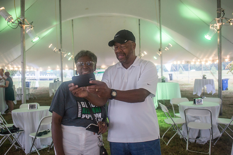 Connie Lawson-Davis, left, and Clarence Harris, right, both alumni of the class of 1967, take a selfie during the Black Alumni Reunion send-off event at Tailgreat Park on Sept. 18, 2016.
