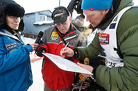 Mats Pettersson signs in at the finish line in Nome on Thursday March 19, 2015 during Iditarod 2015.  <br /> <br /> (C) Jeff Schultz/SchultzPhoto.com - ALL RIGHTS RESERVED<br />  DUPLICATION  PROHIBITED  WITHOUT  PERMISSION