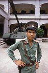 A resolute guard stands outside Hanoi's Armed Forces Military Museum which houses treasured war trophies from the French and American wars, along with many from the Cambodian and Chinese fronts.  (Jim Bryant Photo)......
