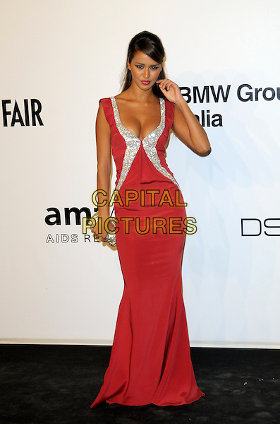 LEILA BEN KHALIFA.The amfAR Gala at La Permanente during the Mailand Fashion Week Spring/Summer 2010 - Milan, Italy. .September 28th, 2009.full length red dress silver tim low cut neckline cleavage hand arm .CAP/RD.©Richard Dean/Capital Pictures.
