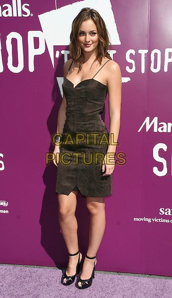 LEIGHTON MEESTER .Marshall's SHOP TIL IT STOPS fundraiser to benefit domestic violence awareness & advocacy programs.in Union Square Park, New York, NY, USA, October 2nd 2008..full length black dress ankle strap shoes peep toe .CAP/LNC.©LNC/Capital Pictures