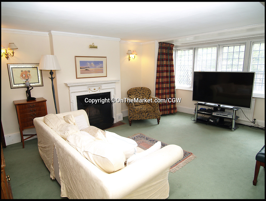 BNPS.co.uk (01202 558833)<br /> Pic: OnTheMarket.com/CGW/BNPS<br /> <br /> The living room.<br /> <br /> A character cottage where literary great George Eliot penned the classic novel Middlemarch has got tongues wagging again after it went on the market for &pound;799,950.<br /> <br /> Brookbank Cottage in Haslemere, Surrey, is where Mary Ann Evans - her birth name - lived temporarily with her married lover George Henry Lewes while their London home was being renovated in 1871.<br /> <br /> They rented the three bed home, which Eliot called a 'queer little cottage', from Anne Gilchrist, another English writer and member of the London Literary Society.