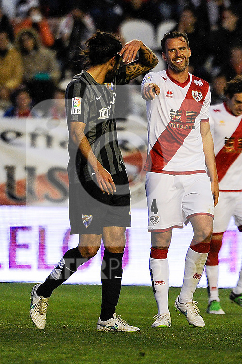 Rayo Vallecano´s Antonio Amaya and Malaga CF´s Marcos Alberto Angeleri during 2014-15 La Liga match between Rayo Vallecano and Malaga CF at Rayo Vallecano stadium in Madrid, Spain. March 21, 2015. (ALTERPHOTOS/Luis Fernandez)