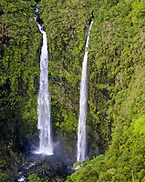 A remote pair of waterfalls only accessible by air, pour into the lush Kauai rainforest.