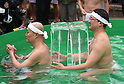 January 8, 2017, Tokyo, Japan - A half-naked man holds on to a block of solid ice added to already freezing cold water during a new years annual rite in downtown Tokyo on a cold Sunday of January 8, 2017. Practitioners of Shinto, a Japanese ethnic religion focusing on ritual practices to be carried out diligently, immerse themselves in icy water under the frigid temperatures in the purification ritual, believed to cleanse the spirit or just to show off their bravery and endurance. (Photo by Natsuki Sakai/AFLO) AYF -mis-