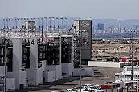 Apr. 7, 2013; Las Vegas, NV, USA: The Las Vegas strip is visible behind the grandstands for the Las Vegas Motor Speedway. Mandatory Credit: Mark J. Rebilas-