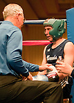 February 3, 2012:   Nevada boxer Tylor Yancey talks with his trainer in between rounds of his match held at the Eldorado Convention Center on Friday night in Reno, Nevada.