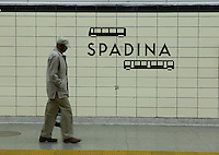 A man walks in the Spadina subway Station in Toronto April 24, 2010. The Toronto subway and RT system is a rapid transit system in Toronto, Ontario, Canada, consisting of both underground and elevated railway lines, operated by the Toronto Transit Commission (TTC).