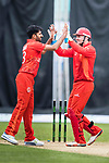 Tanwir Afzaal of HKI United (L) celebrates with his teammate James Atkins (R) during the Hong Kong T20 Blitz match between Kowloon Cantons and HKI United at Tin Kwong Road Recreation Ground on March 11, 2017 in Hong Kong, Hong Kong. Photo by Chris Wong / Power Sport Images