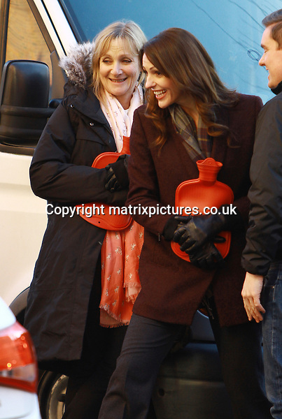 NON EXCLUSIVE PICTURE: MATRIXPICTURES.CO.UK.PLEASE CREDIT ALL USES..WORLD RIGHTS..English actresses Lesley Sharp and Suranne Jones are pictured filming Scott And Bailey detective drama in Manchester...The cast keep warm with hot water bottles in between takes...NOVEMBER 29th 2012..REF: IRF 125646