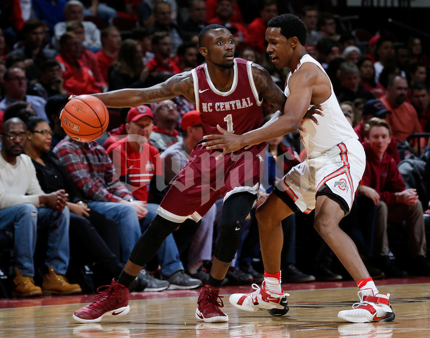 Ohio State Buckeyes guard C.J. Jackson, right, defends against North Carolina Central Eagles guard C.J. Wiggins (1) during the first half of a NCAA Division I men's basketball game between the Ohio State Buckeyes and the North Carolina Central Eagles on Monday, November 13, 2016 at Value City Arena in Columbus, Ohio. Ohio State leads North Carolina Central 31-29 at halftime. (Joshua A. Bickel/The Columbus Dispatch)