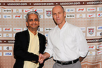 U.S. Soccer President Sunil Gulati shakes hands with head coach Bob Bradley during a photo opportunity prior to a press conference announcing a contract extension for U. S. Men's National Soccer Team head coach Bob Bradley in New York, NY, on August 31, 2010.